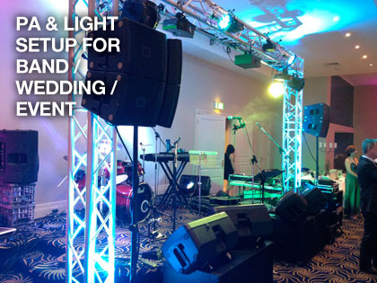 the sound guys setup for band at wedding event, pa and light hire